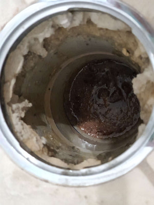 how to clear concrete from drain pipes